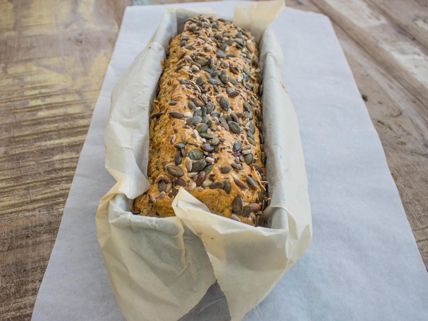 bread tin with bread dough rising